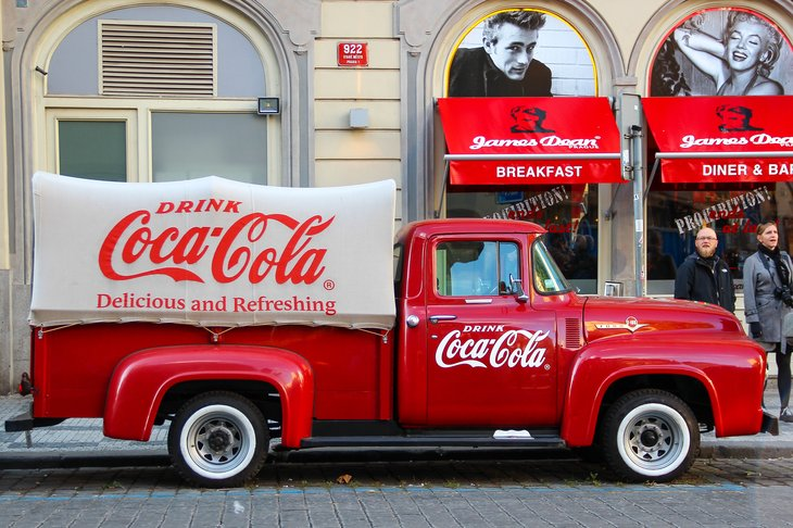 Old fashioned CocaCola pickup truck on a city street