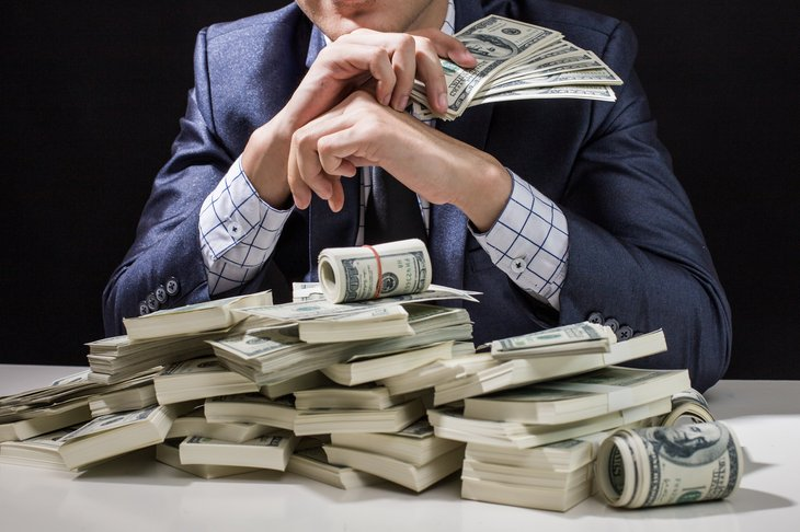 Wealthy businessman with cash